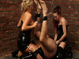 Two Dommes Beating Their Slave