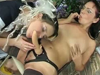 Doll-faced girl goes down with a mature lez tutor getting a strap-on lesson