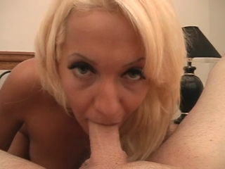 Blonde stroking and sucking a hard cock