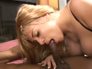 Tatiana Stone impaled on a black pole