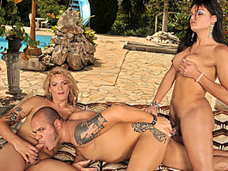 Blond and Brunette Shemales Suck and Fuck Cocks