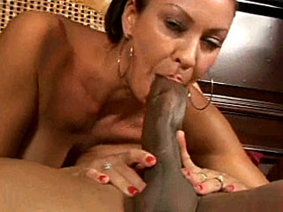 Hot lady blows and strokes his big black cock
