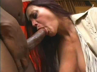 Busty lady sucks a big cock and takes it in her wet pussy