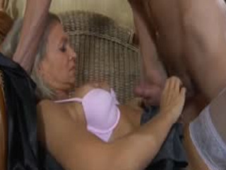 Sultry mom hungrily gags on a guy's sturdy dick before spreading her legs