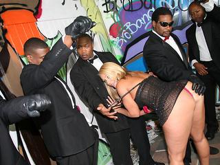 Hot slut Melanie Monroe serving huge black dicks
