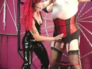 Domina Melissa torments crossdresser slave