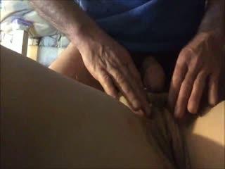 He rubs her muff while masturbating