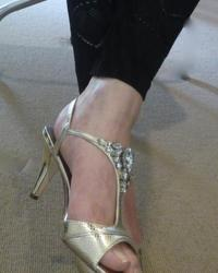 Gold heels and black footless tights