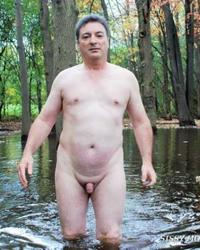 MOUNIR MOURACADE NUDE IN A POND