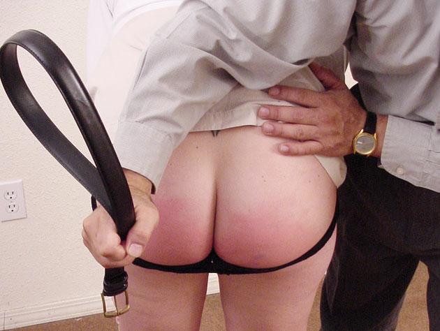 A belt on the bare butt