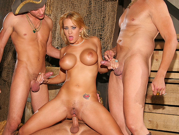 Busty blonde gets three cocks