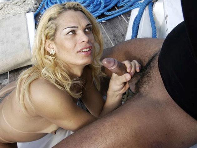 Blonde slut jerks big cock