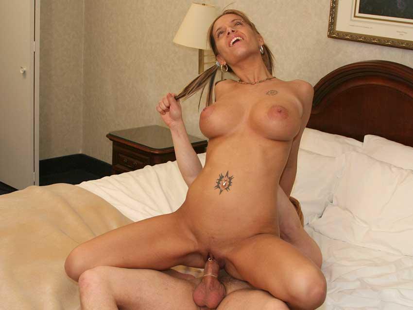 Busty Pamela riding a dick