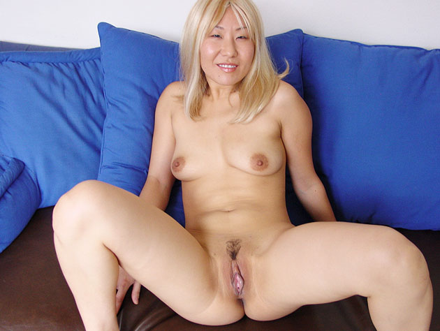 Blonde asian MILF feels naughty