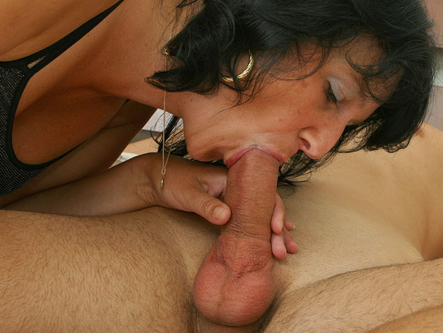 Mature Brunette Bitch Slurps On A Cock