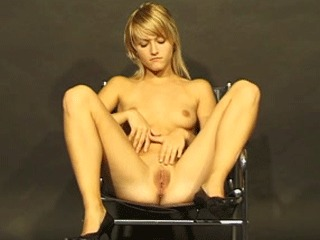 A cute blonde takes off her clothes