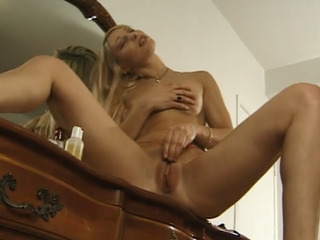 Horny MILF masturbating at home