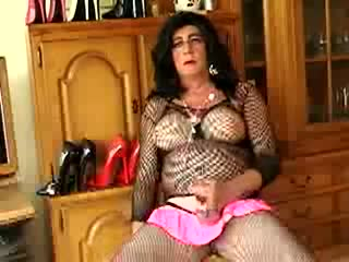 Crossdresser In Fishnet Lingerie And High Heels Strokes Cock