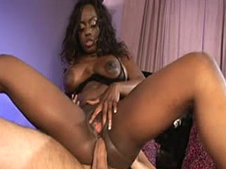 Ebony babe gets a double-dick sandwich