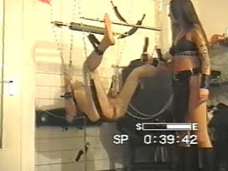 Ballbusting with a dildo 2