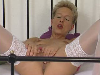 Blonde With Short Hair Rubs And Fingers Her Pussy On The Bed