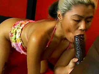 Blonde slut blows a black dick