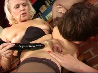 Two Mature Lesbians Playing With A Dildo