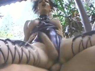 Latex tranny gets nailed in her butthole