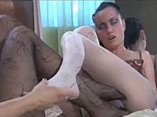 Clad In Patterned Open Crotch Pantyhose Lesbians Going For Heated Foot Sex