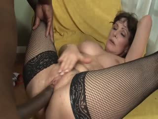 Mature Brunette And A Stiff Black Rod