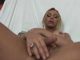 Blonde Shemale Playing With Her Big Round Tits