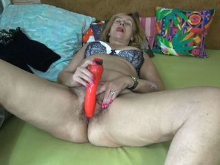Granny With Hairy Pussy Is Playing With Dildo
