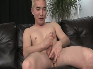 Blonde Asian guy jerking off
