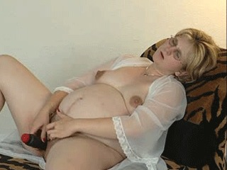 A horny pregoo plays with her pussy