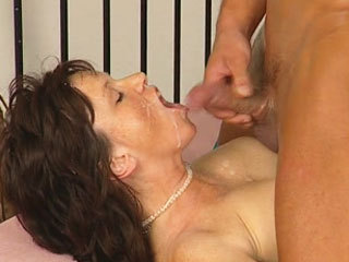 German MILF handling a young cock