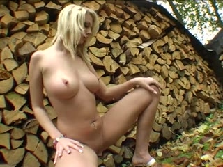 Posing by the firewood