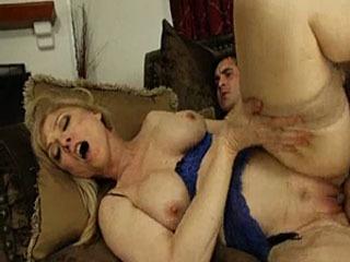 Nina Hartley Takes A Young Cock