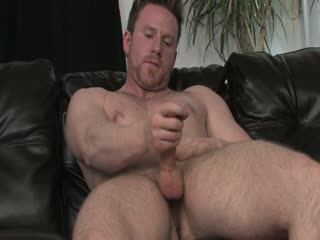 Sexy stud strokes his hard dick