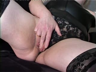 Hot Granny In Black Stockings Rubs Her Wet Pussy