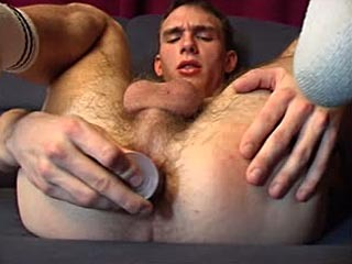 Young guy masturbates with a dildo