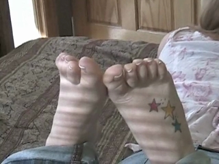 Sexy Mackenzie Showing Off Her Feet On The Bed