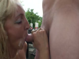 Blonde mature double teamed in a park