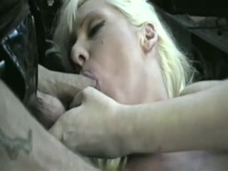Two sluts handling a huge cock