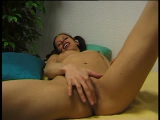Pigtailed german amateur plays with her clit