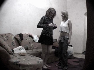 Two Chicks Getting Dressed