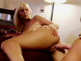 Two busty blondes fucking with sex toys