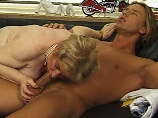 German granny pleasing a young stud