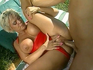 Big titted blonde rides a big dick by the pool