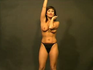 Hot Babe Performs A Striptease