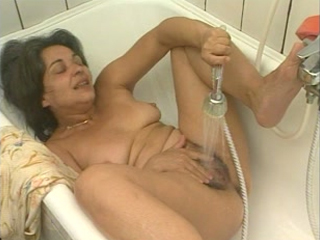 Horny Housewife Pleasing Herself In A Bathtub